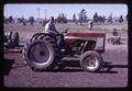 Unidentified man on tractor at Central Oregon Branch Experiment Station, circa 1965