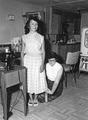 Mary Anne Crocker measures the hem of a skirt for a young homemaker on the Warm Springs Indian Reservation