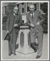 U.G. Dubach and Frank Magruder standing next to the sundial outside Commerce Hall