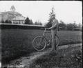 E. E. Wilson with bicycle