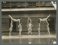 Women's gymnastic team in a gymnastic formation, circa 1930s