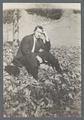 Man sitting on leaf-covered grass, circa 1910