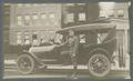 Sergeant Major Dennis Hayes with automobile, circa 1918