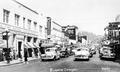 Downtown Eugene with cars lined up at a stop, circa 1955