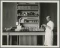 Working with lab glassware, circa 1920