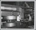 James Brady and Edwin Yunker with the OSC cyclotron