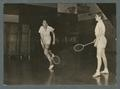 Two women playing badminton in gym class, 1938