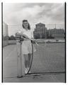 Jeanne Hetherington posing on the tennis courts south of Weatherford Hall