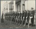 Cadet officers with sabres in front of the Administration Building