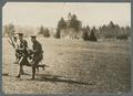Cadets running with rifles on lower campus, circa 1920